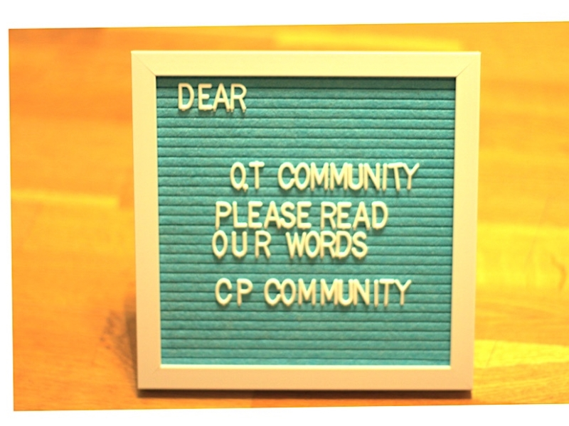A blue letter board that reads 'dear OT community please read out words CP community'